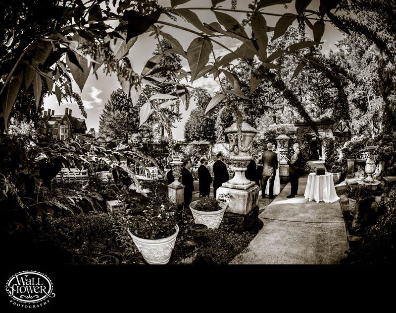 Wedding ceremony by fisheye in Thornewood Castle garden