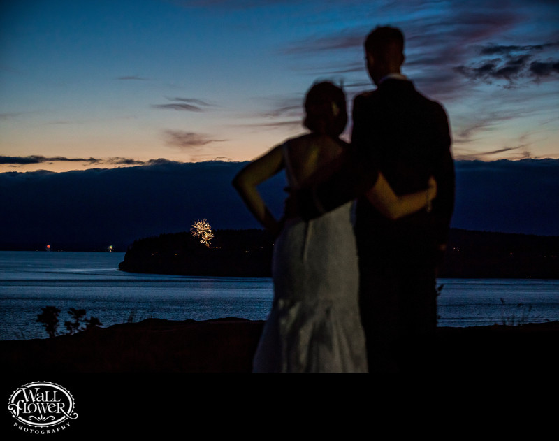 Bride and groom watch fireworks from Chambers Bay patio