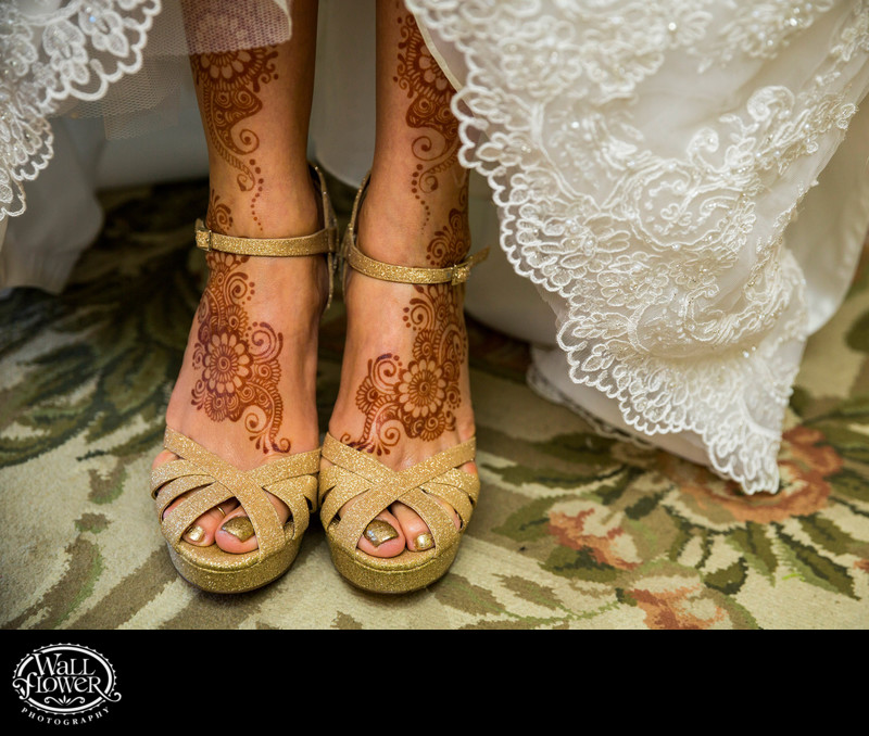 Detail of henna patterns on bride's feet and legs