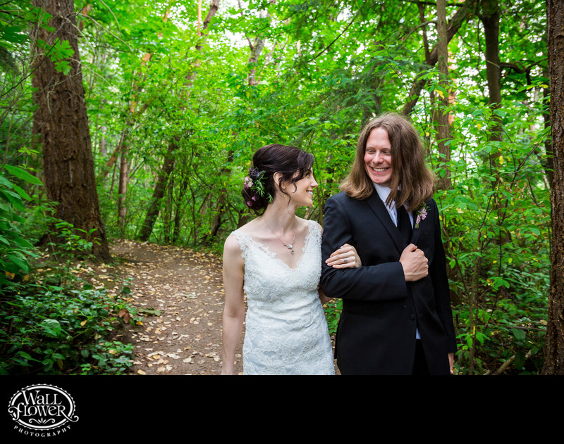 Bride and groom walk through St Edwards Park forest