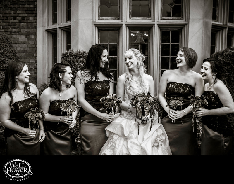Bride and bridesmaids laugh by Thornewood Castle window