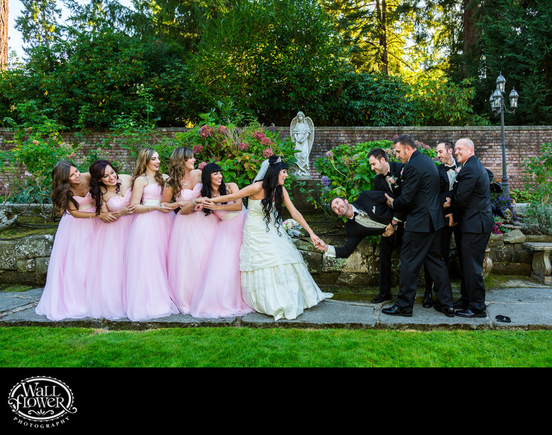 At Thornewood Castle, wedding party jokingly attempts to pull bride and groom apart