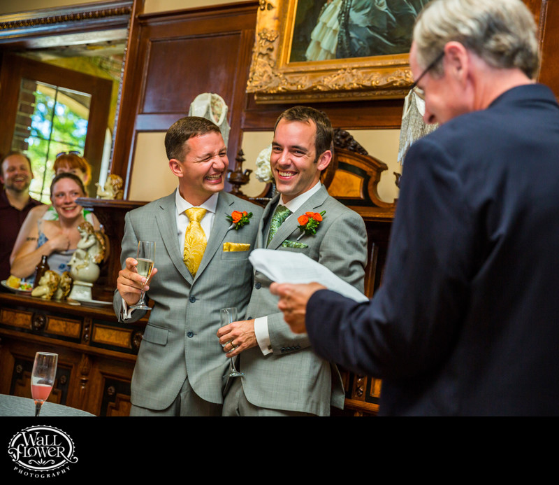 Grooms react to dad's toast during wedding reception