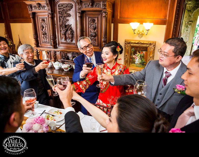 Chinese families toast bride and groom at wedding