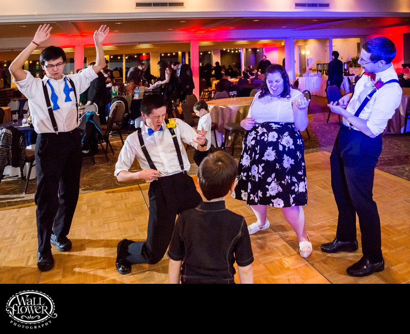 Bride, groom and groomsmen rock the air guitar