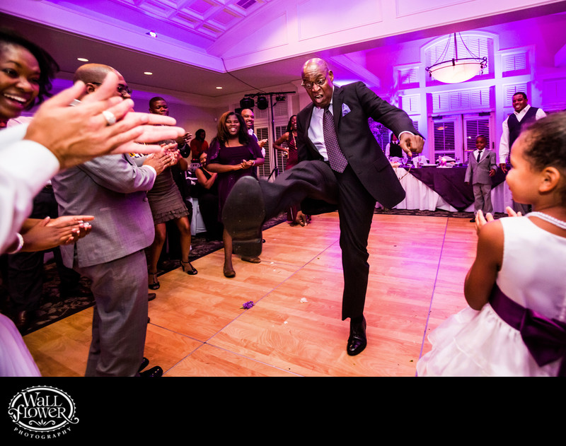 Wedding guest performs high kick on dance floor
