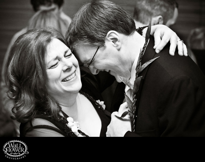 Bride's parents laugh while dancing during reception