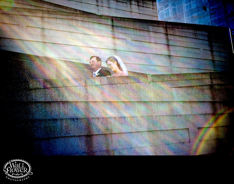 Sun flares as bride and father descend ramp to wedding