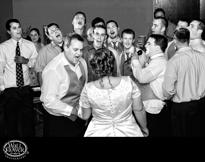 Groom and friends serenade bride during Hollywood Schoolhouse wedding