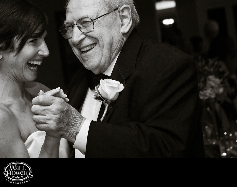 Bride dances with grandpa during wedding reception