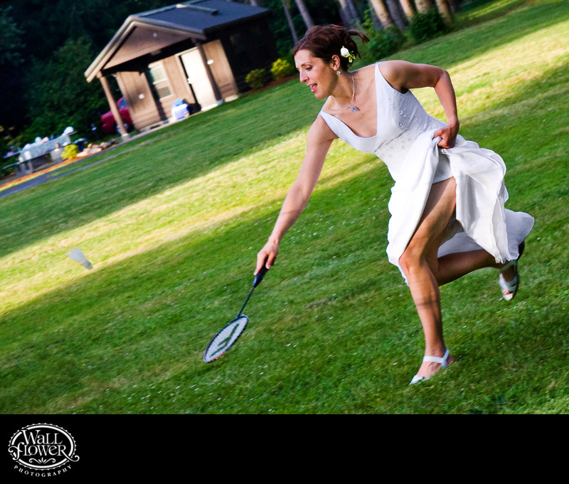 Bride chases shuttlecock while playing badminton on her wedding day