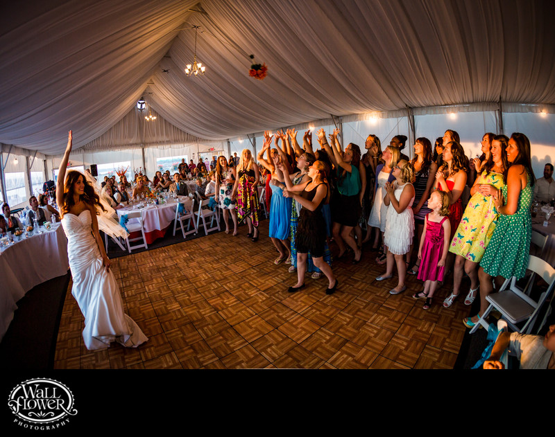 Bride tosses bouquet in Chambers Bay wedding pavilion