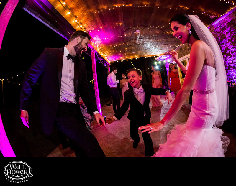 Fisheye photo of groom's son dancing at wedding party