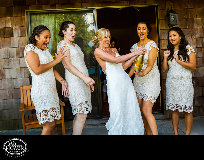 Bride and bridesmaids startle as champagne cork pops