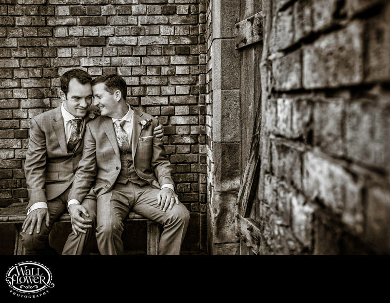 Two grooms on bench in Thornewood Castle sunken garden