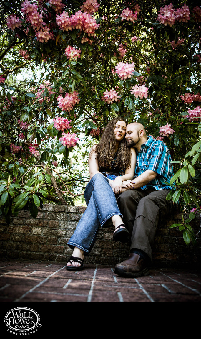 Engagement portrait on brick wall at Lakewold Gardens