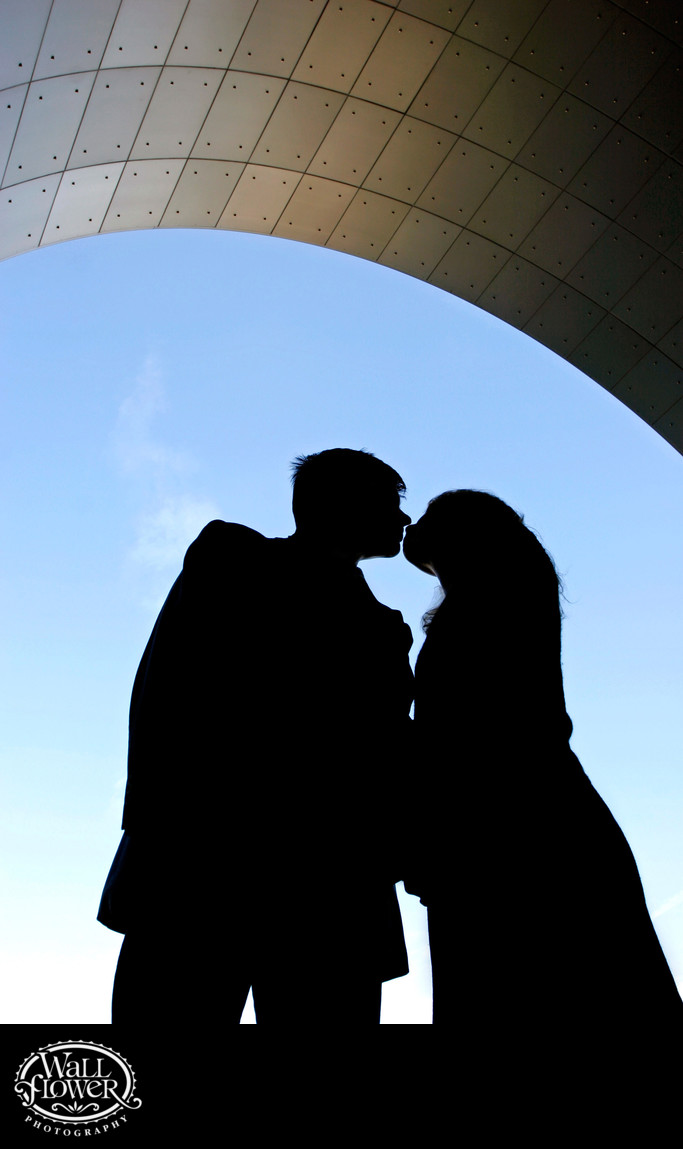 Engagement portrait kiss silhouette at History Museum