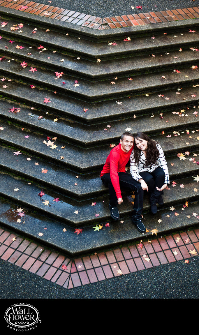 Engagement portrait on angled stairs shot from overhead
