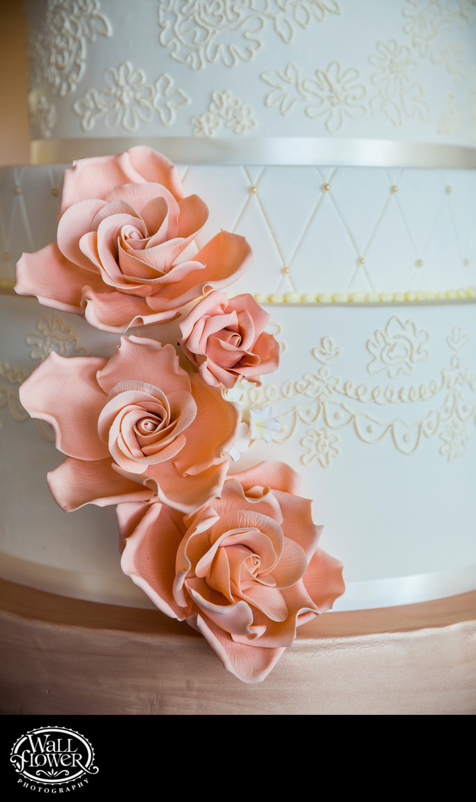 Detail of sugar flowers on ornate wedding cake