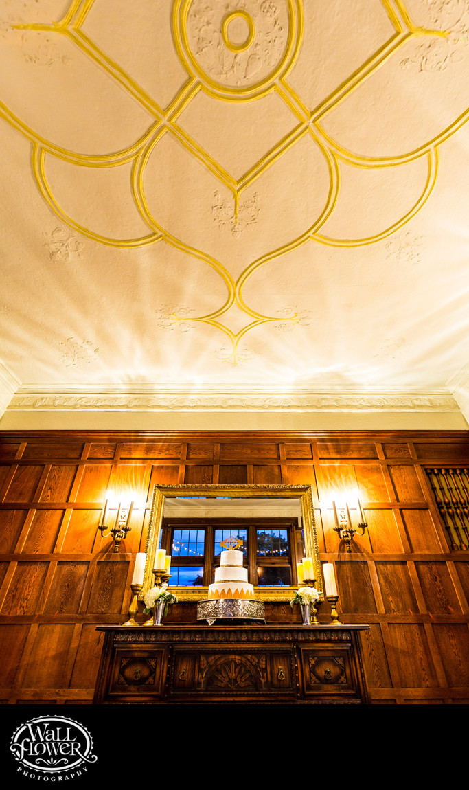Detail of art deco wedding cake and ornate ceiling