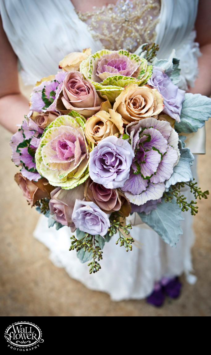 Detail of bride's bouquet of pale flowers and cabbages