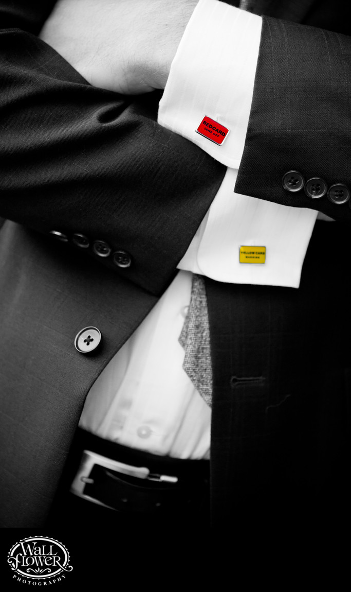 Detail of groom's soccer-themed cufflinks