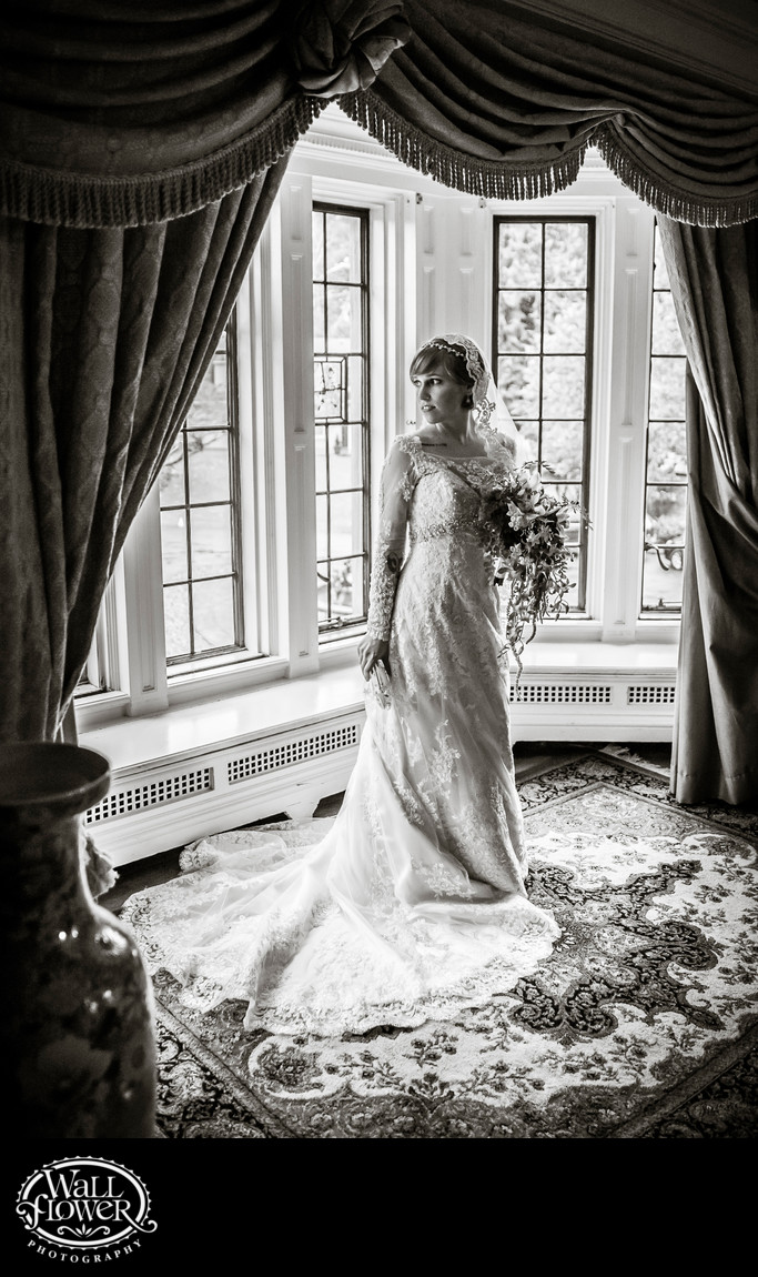 Bride in Anna's Suite bay windows at Thornewood Castle