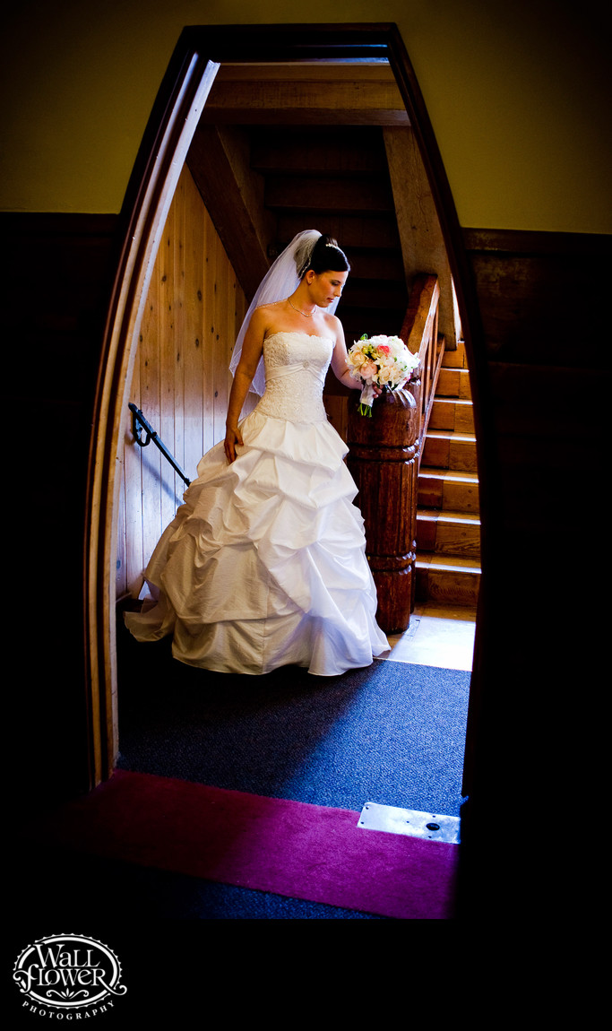 Bride framed by curved doorway in Timberline Lodge