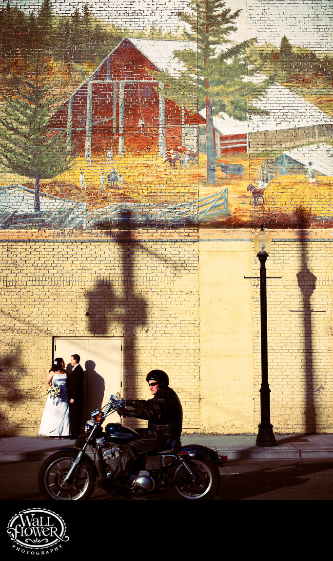 Motorcyclist photobombs portrait by Centralia mural