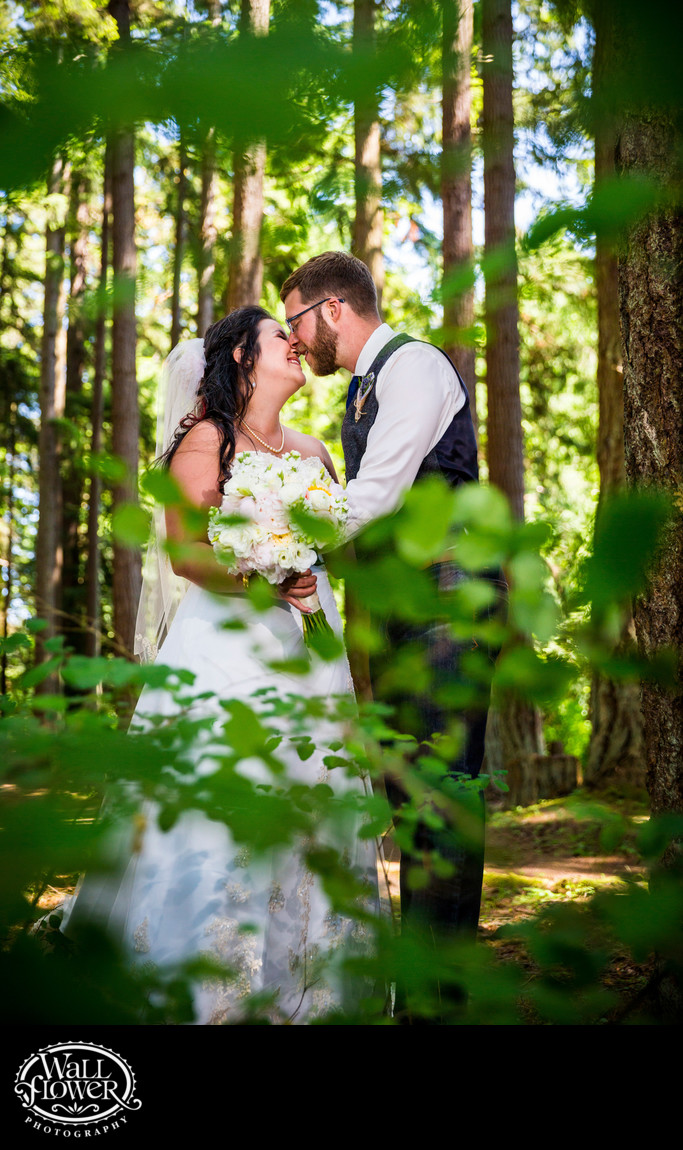 Kissing bride and groom in Kitsap Memorial forest