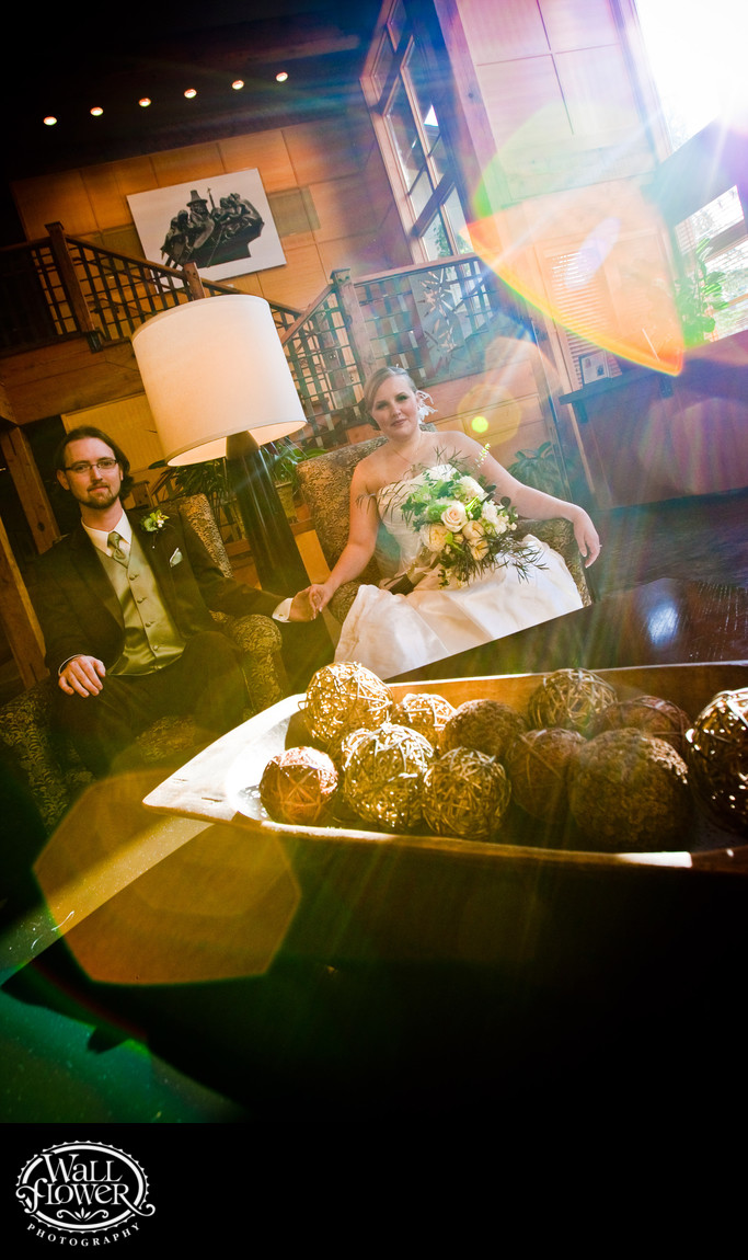 Lens flares over bride and groom in Willows Lodge lobby