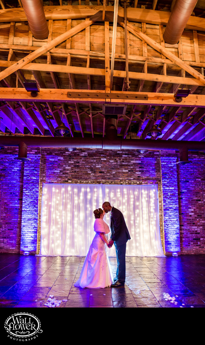 Bride and groom kiss at Historic 1625 Tacoma Place