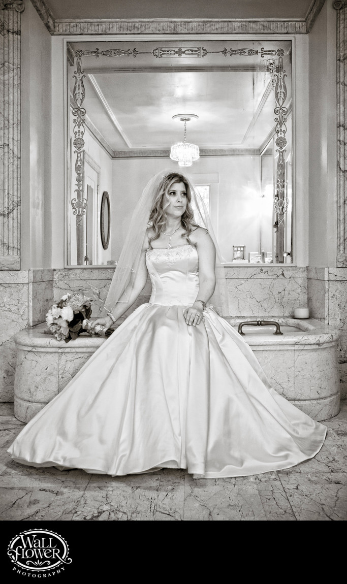 Bride sits in Wagner House bathroom at Lakewold Gardens