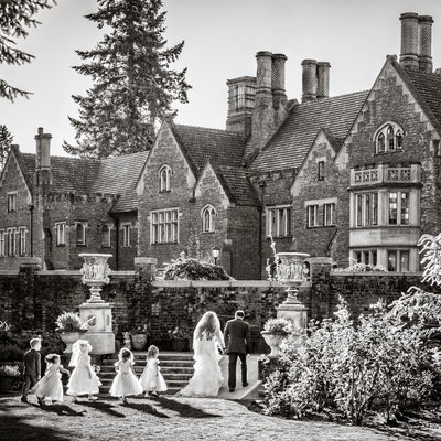 Flower girls, ring bearer follow bride and groom out of sunken garden toward Thornewood Castle