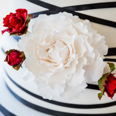 Detail of intricate sugar flower on wedding cake