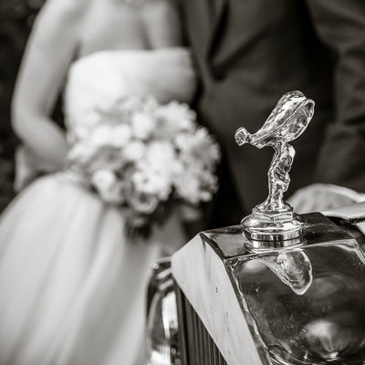 Detail of Rolls-Royce hood ornament with bride, groom