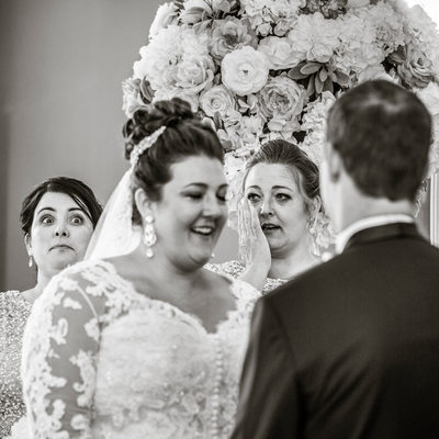 Bridesmaids react variously to emotional wedding ceremony