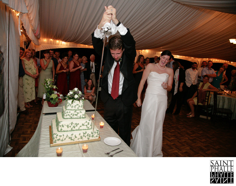 Mountain Top Inn Wedding Groom Cutting Cake With Sword