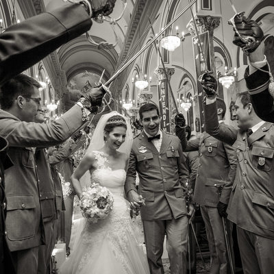 Military couple leaving the church after ceremony - Wedding Photographer