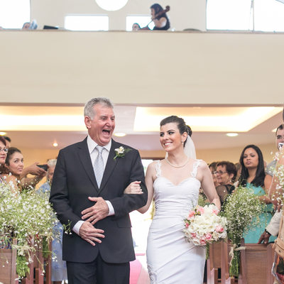 Happy father carrying the bride to the altar - Wedding Photographer