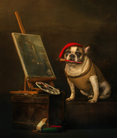 Photograph of a French Bulldog being a french painter