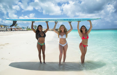 Resort World Bimini Three Woman Surfboard Photo