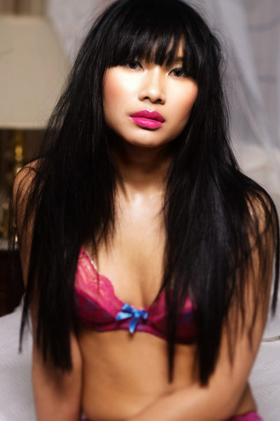 Black Hair Asian woman Pink Colored Lips photo
