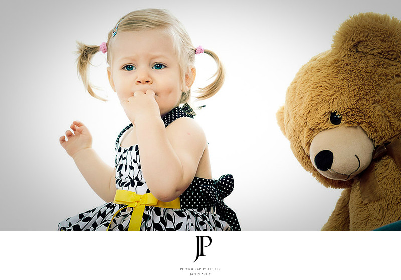 Family Photographer Girl With Her Toy in Studio Plachy