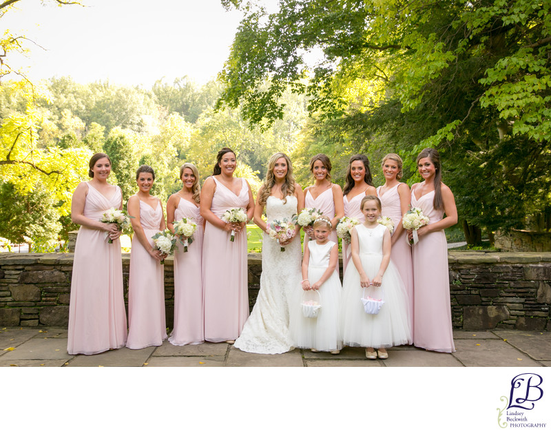 Blush pink wedding party with white flowers