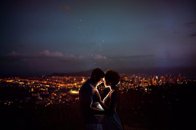 Beautiful nighttime picture of a couple embracing.