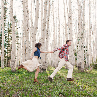 Playful Engagement Session in a Field of Aspens