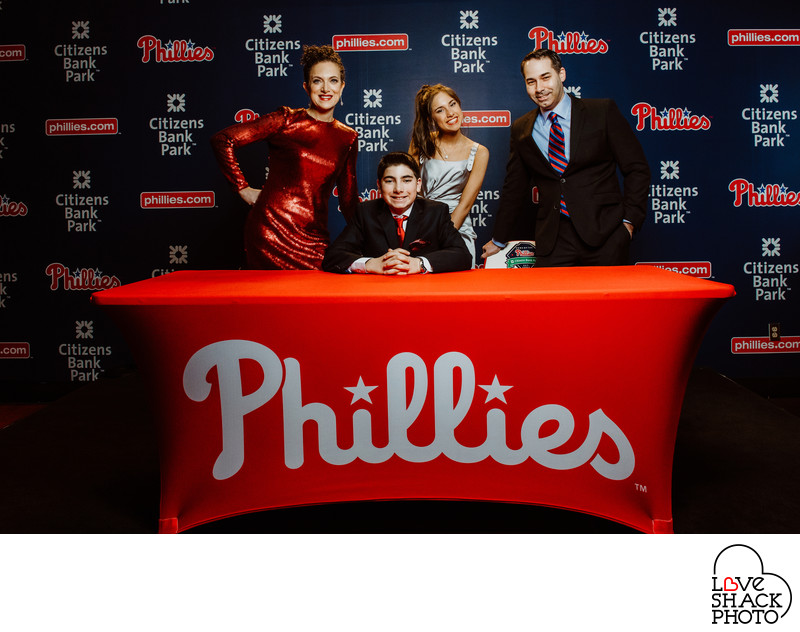 Max and Family Pose in Philadelphia Phillies Media Room