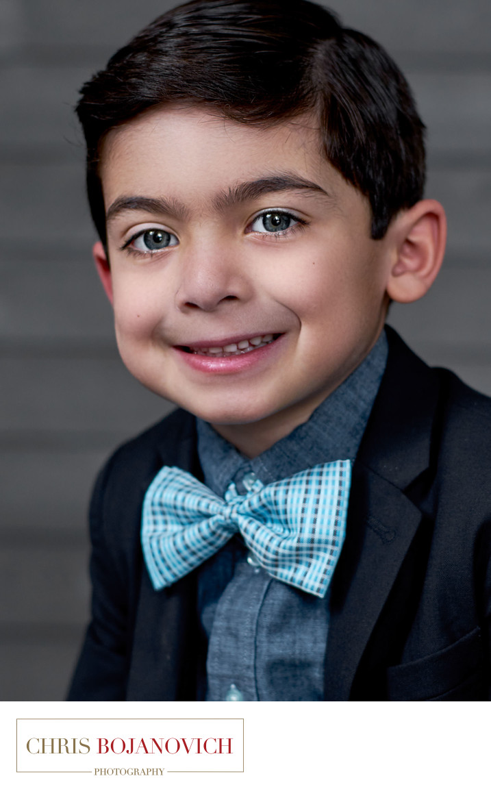 blue eyes boy with suit and tie