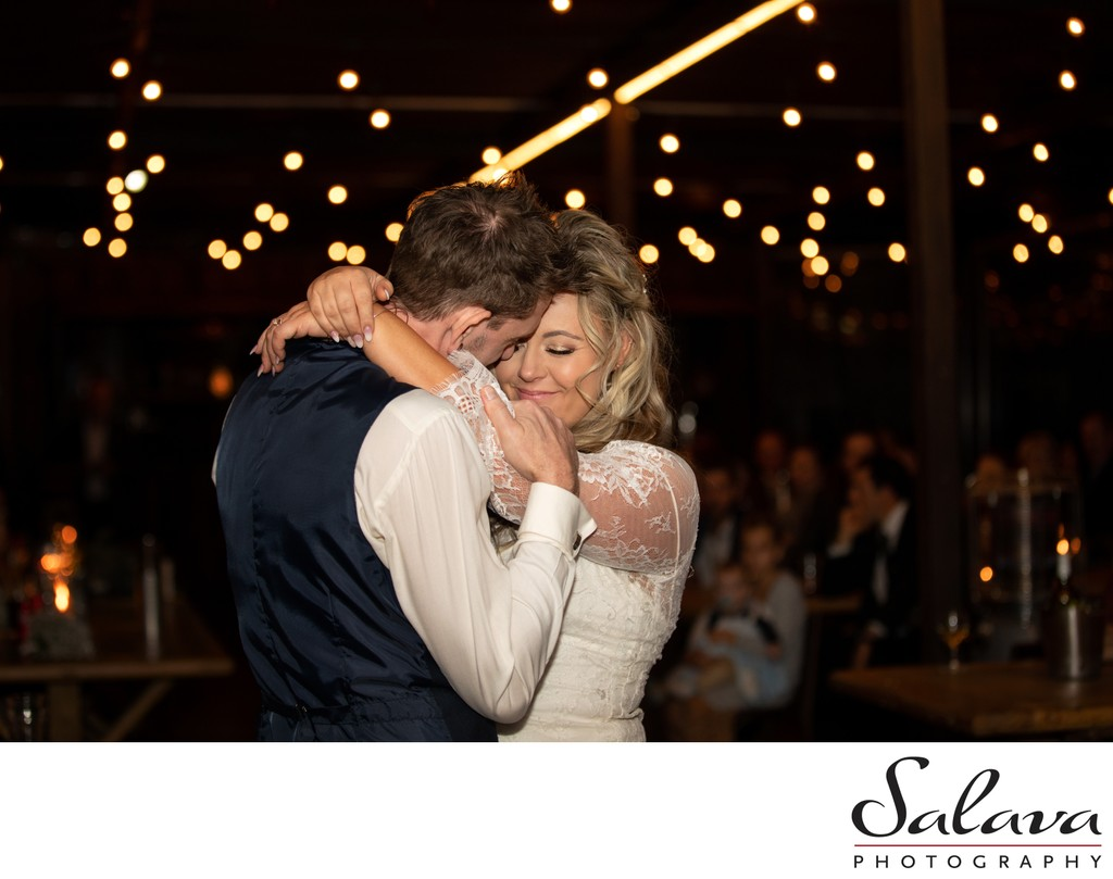 Bride and groom dance at Murray's Craft Brewing Co